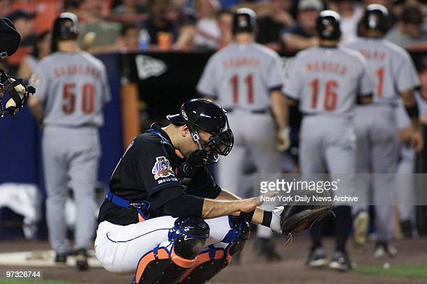 New York Mets catcher Mike Piazza gestures to calm down pitcher Satoru Komiyama after Komiyama gave up a threerun homer in the fifth inning at Shea...