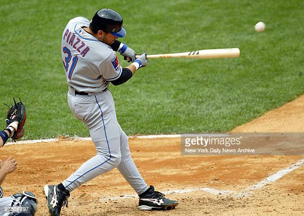 New York Mets' catcher Mike Piazza hits a single to left field to score Hideki Matsui in the fourth inning of game against the New York Yankees at...