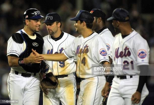 New York Mets catcher Mike Piazza is congratulated by teammates Todd Ziele Robin Ventura Armando Benitez and Bobby Jones after the Mets beat the...