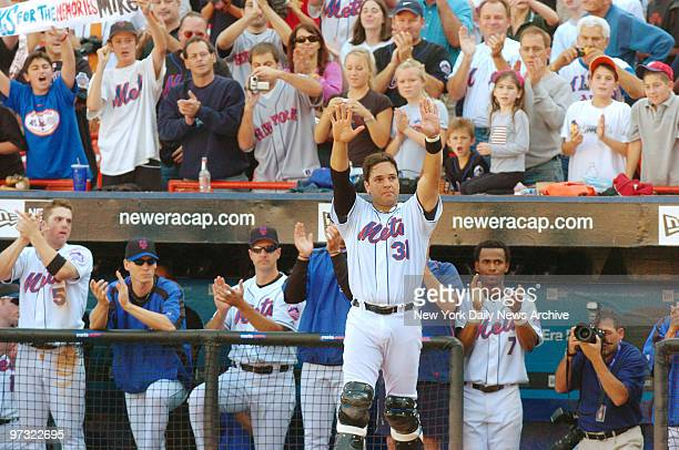 New York Mets' catcher Mike Piazza waves to fans during the seventhinning stretch when a video tribute to him was shown at Shea Stadium Piazza played...