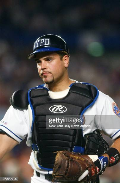 New York Mets' catcher Mike Piazza wears a New York City Police Department logo on his cap as he plays against the Atlanta Braves at Shea Stadium in...