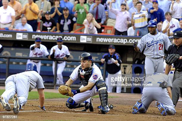 New York Mets' catcher Paul Lo Duca waits to tag Los Angeles Dodgers' JD Drew at home plate after tagging Jeff Kent in an unusual double play in the...