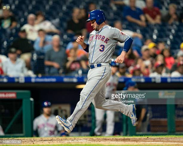 New York Mets Catcher Tomas Nido scores a run on a sacrifice fly ball during the fifth inning of a Major League Baseball game between the New York...
