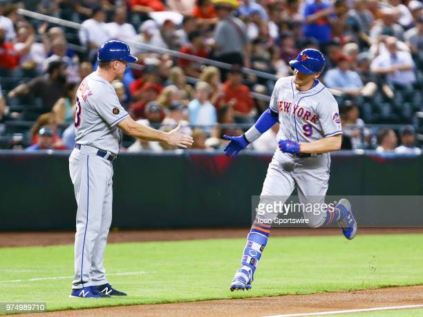 New York Mets center fielder Brandon Nimmo gives a high five to New York Mets third base coach Glenn Sherlock during the MLB baseball game between...