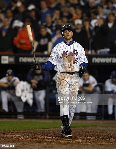 New York Mets' center fielder Carlos Beltran strikes out looking in the ninth to end Game 7 of the National League Championship Series against the...