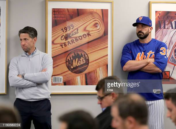 New York Mets chief operating officer Jeff Wilpon and manager Mickey Callaway of the New York Mets listen to Mets general manager Brodie Van Wagenen...