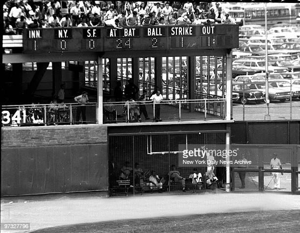 New York Mets' Cleon Jones leaps up against bullpen screen in leftfield in vain attempt to catch ball hit by Willie Mays in first inning Ball bounced...