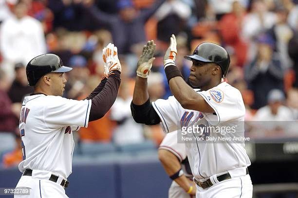 New York Mets' Cliff Floyd gets a highfive from teammate Carlos Beltran after hitting a tworun homerun in the fourth inning against the Atlanta...