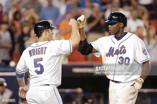 New York Mets' Cliff Floyd is congratulated by teammate David Wright who scored on Floyd's tworun homer in the eighth inning against the Pittsburgh...