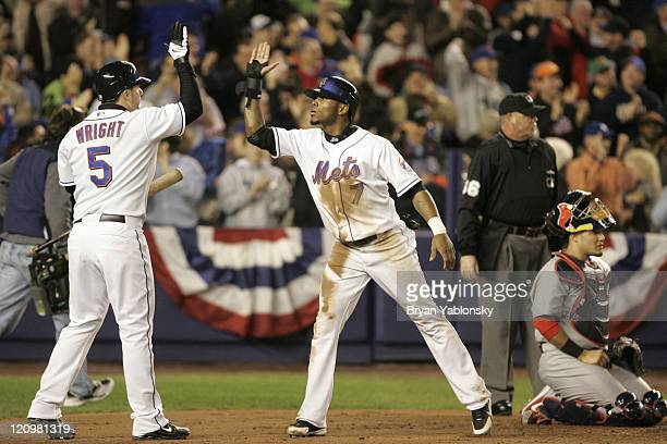 New York Mets David Wright greeting Jose Reyes at home plate after scoring on home run by Carlos Delgado during game 2 of the MLB National League...