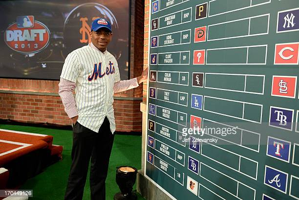 New York Mets draftee Dominic Smith poses near the draft board at the 2013 MLB FirstYear Player Draft at the MLB Network on June 6 2013 in Secaucus...