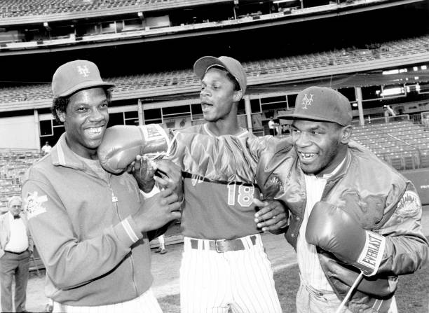 New York Mets' Dwight Gooden laughs off a right from heavywe