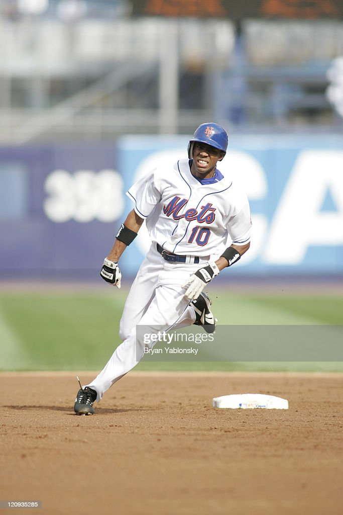 New York Mets Endy Chavez rounding second base in a regular season game against the Florida Marlins played at Shea Stadium in Flushing, N.Y. Mets defeated the Marlins 17 - 3 on July 8, 2006.