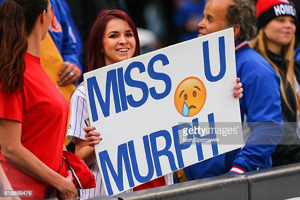 New York Mets fans hold up signs for Washington Nationals second baseman Daniel Murphy prior to the game between the New York Mets and the Washington...