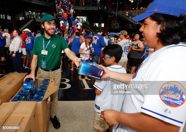 New York Mets fans receive their Noah Syndergaard bobbleheads prior to a game between the Mets and the Oakland Athletics on July 22 2017 at Citi...