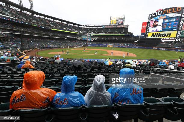 New York Mets fans sit in the rain watching the New York Mets play against the Toronto Blue Jays during their game at Citi Field on May 16 2018 in...