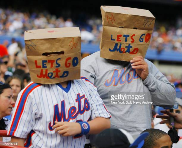 New York Mets' fans wearing paper bags over their heads still cheer on their team during a game against the Florida Marlins at Shea Stadium The Mets...