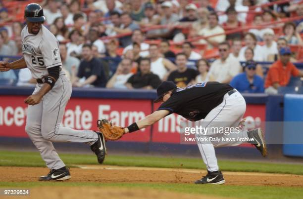 New York Mets' first baseman Jason Phillips puts the tag on Florida Marlins' Derrek Lee during a pick-off play in the second inning. The Marlins went...