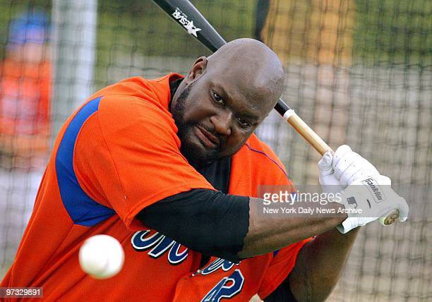 New York Mets' first baseman Mo Vaughn takes swings in the batting cage at the team's spring training camp in Port St Lucie Fla