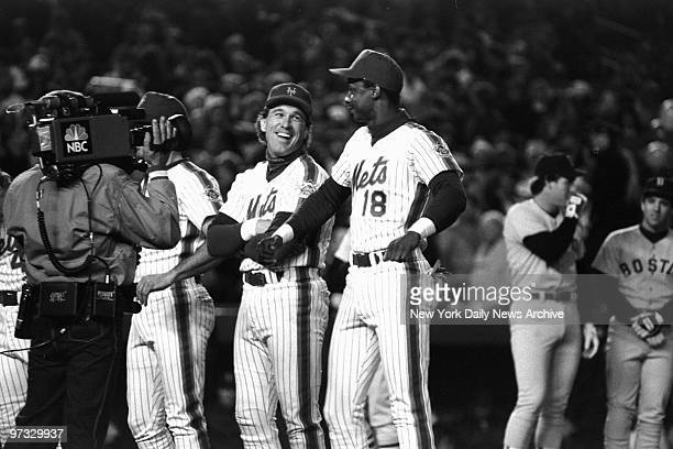 New York Mets' Gary Carter and Darryl Strawberry share a laugh during pregame introductions at Shea Stadium prior to Game One of the 1986 World...