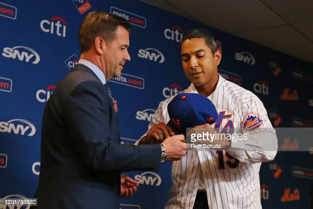 New York Mets General Manager Brodie Van Wagenen presents new manager Luis Rojas with a cap before talking to the media at Citi Field on January 24...