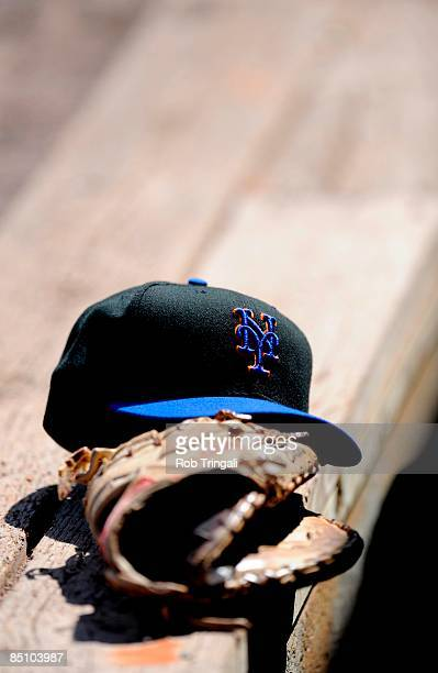 New York Mets helmet and glove are shown during a spring training game between the New York Mets and Baltimore Orioles at Fort Lauderdale Stadium on...