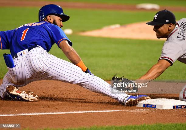 New York Mets Infield Amed Rosario slides safely into 3rd under the tag of Atlanta Braves Infield Johan Camargo during a MLB game between the New...