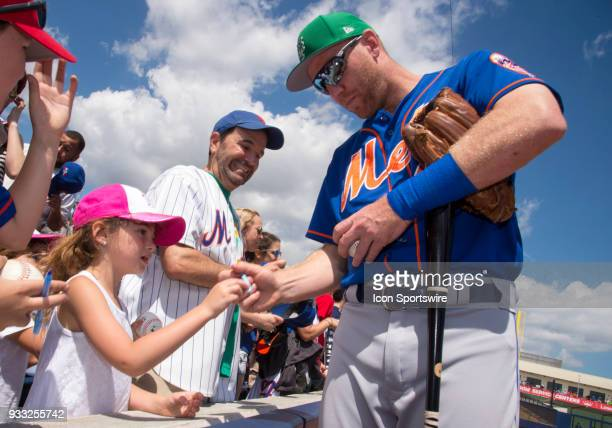 New York Mets Infielder Todd Frazier signs autographs for New York Mets fans before start of the St Patrick's Day MLB spring training game between...