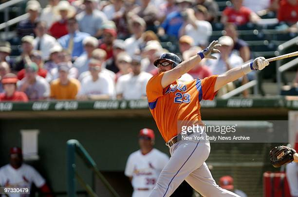 New York Mets' Jason Phillips connects for a solo homer in the second inning of a Grapefruit League game against the St. Louis Cardinals at Roger...