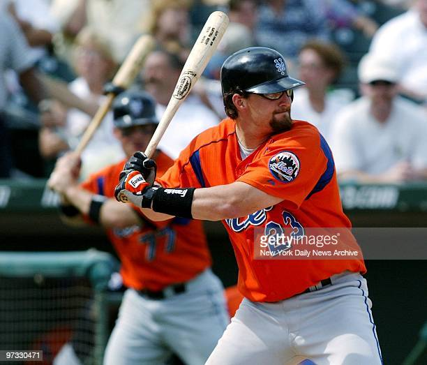 New York Mets' Jason Phillips has a double in teammate Russ Johnson as he gets ready to swing during exhibition game against the St. Louis Cardinals.