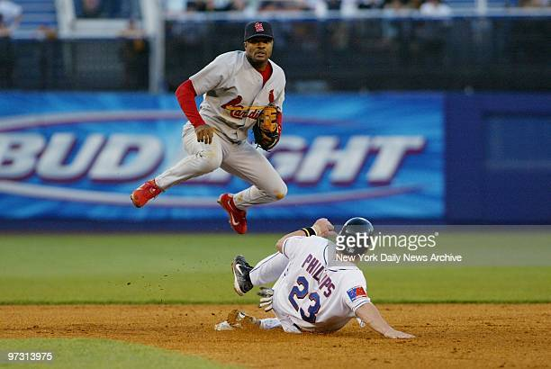 New York Mets' Jason Phillips is out at second as St. Louis Cardinals' Tony Womack turns the double play in the second inning at Shea Stadium. The...
