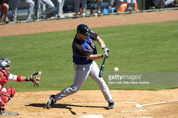 New York Mets' Jason Phillips makes a hit to score teammate Carlos Beltran during pre-season game against the Washington Nationals in Viera, Fla. The...