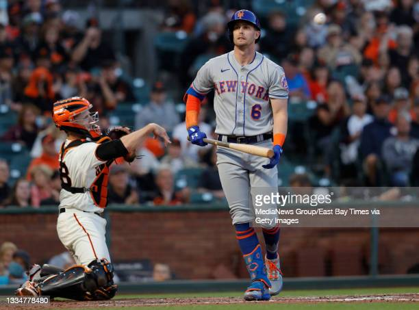 New York Mets' Jeff McNeil reacts after striking out against San Francisco Giants starting pitcher Kevin Gausman in the fourth inning of their MLB...