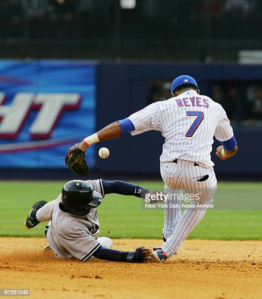 New York Mets' Jose Reyes bobbles a doubleplay ball in the eighth inning as Yanks' Tony Womack slides in safely at second base The New York Yankees...