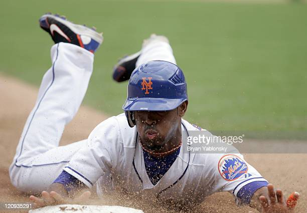 New York Mets Jose Reyes stealing third base during game 1 of doubleheader against the Florida Marlins played at Shea Stadium in Flushing NY Mets...