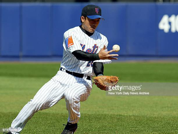 New York Mets' Kaz Matsui bobbles the ball and fails to get the out at first during the eighth inning of game against the Milwaukee Brewers at Shea...