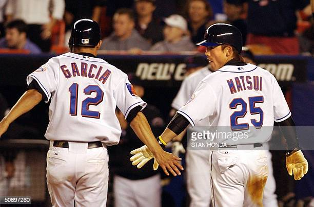 New York Mets Kaz Matsui celebrates with Danny Garcia as they both score on a hit by Cliff Floyd against the Philadelphia Phillies in 7th inning of...