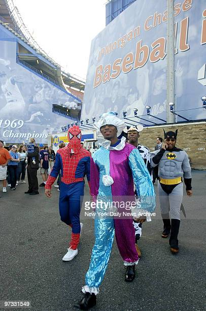 New York Mets' Kaz Matsui is dressed as Spiderman Jose Reyes is a clown and Victor Diaz is Batman during Mets Annual Rookie hazing event following a...