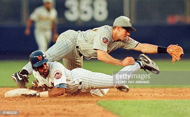 New York Mets' Lance Johnson is forced out at second by the Pittsburgh Pirates' shortstop Kevin Polcovich when he tried to advance on Bernard...