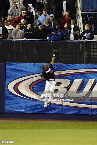 New York Mets' left fielder Cliff Floyd makes a leaping catch to take away a tworun homer in the seventh inning of a game against the Philadelphia...