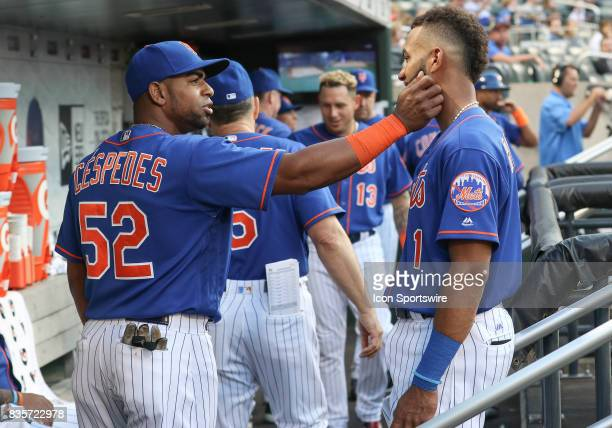 New York Mets Left Fielder Yoenis Cespedes jokingly plays with New York Mets Infielder Amed Rosario's beard in the dugout prior to the Major League...