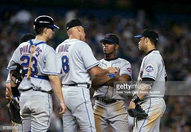 New York Mets' manager Art Howe soothes rookie shortstop Jose Reyes on the mound during a pitching change in the seventh inning of the third Subway...
