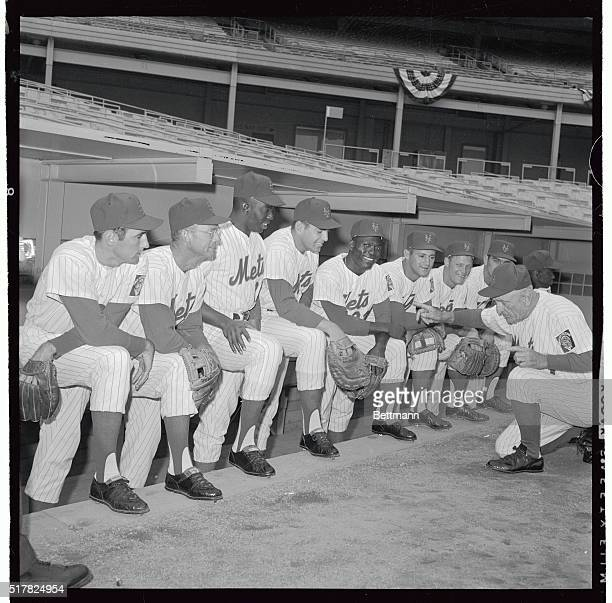 New York Mets' manager Casey Stengel goes down on his knees as he readies his starting lineup for the season opener against the Los Angeles Dodgers...