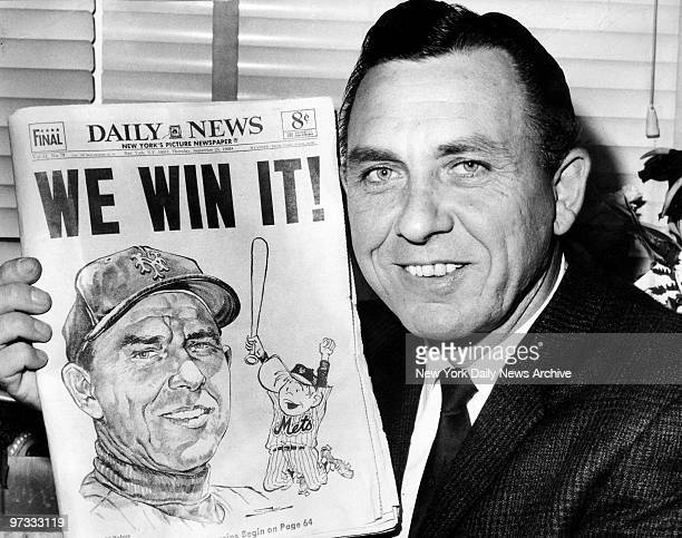 New York Mets' manager Gil Hodges holds up copy of the Daily News proclaiming amazin' victory over the St Louis Cardinals for National League East...