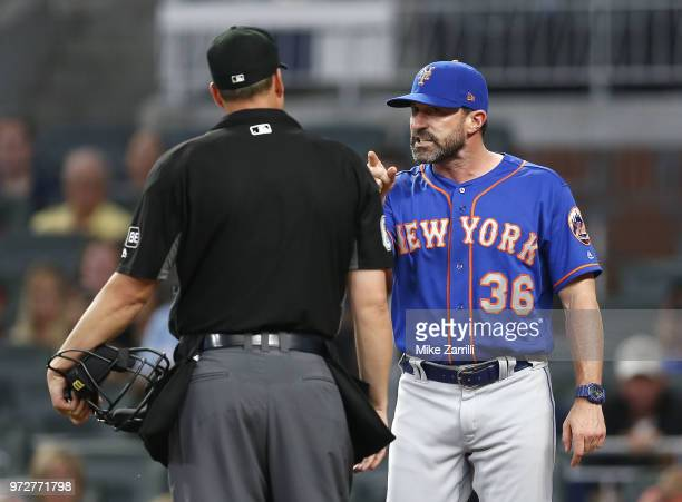New York Mets manager Mickey Callaway argues with home plate umpire Stu Scheurwater after being ejected in the sixth inning during the game against...
