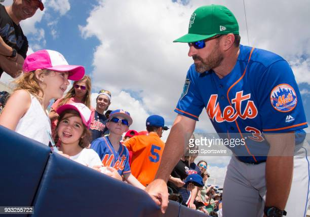 New York Mets Manager Mickey Callaway signs autographs and talks with two young New York Mets fans before start of the St Patrick's Day MLB spring...