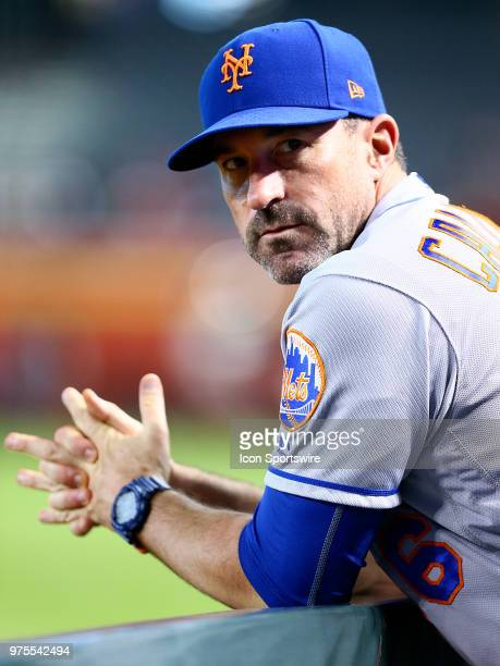 New York Mets manager Mickey Callaway stands in the dugout during the MLB baseball game between the Arizona Diamondbacks and the New York Mets on...