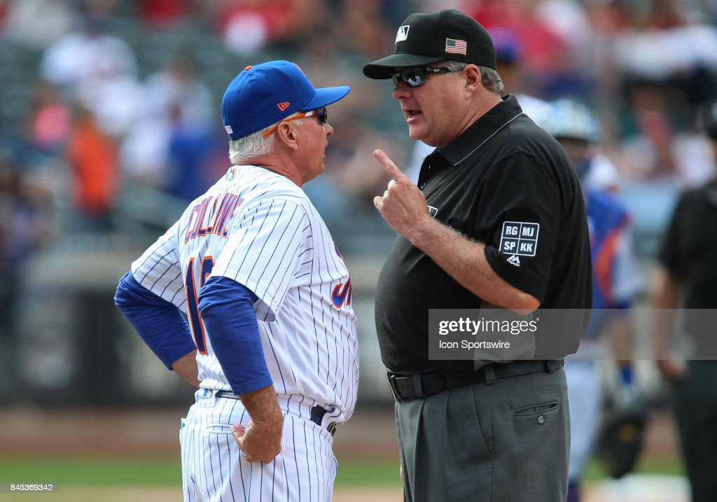 New York Mets Manager Terry Collins (10) argues with First Base Umpire Jerry Lane (24) after a challenged play at home plate was reversed, giving the Reds a 2-run lead during the eighth inning of the Major League Baseball game between the Cincinnati Reds and the New York Mets on September 10, 2017 at Citi Field in Flushing, NY.