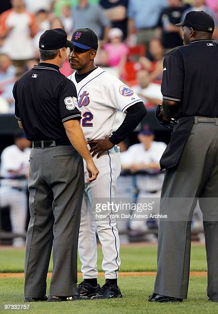 New York Mets' manager Willie Randolph argues with umpire Tim Timmons as home plate umpire Chuck Meriwether looks on during a game against the San...