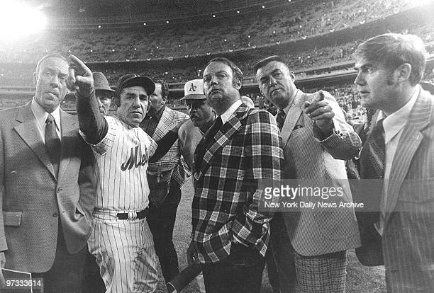 New York Mets' manager Yogi Berra gives his rival manager Oakland A's manager Dick Williams of the Oakland A's and umpiring crew the lowdown on...